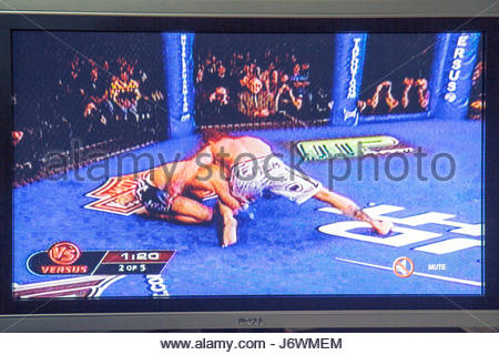 Miami Beach Florida television TV flat panel screen monitor cable channel MMA mixed martial arts fighting - Stock Photo