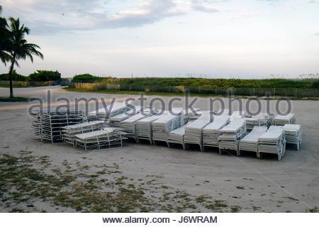 Miami Beach Florida Lummus Park rental lounge beach chairs - Stock Photo