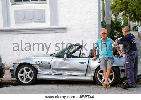 Miami Beach Florida Fourth 4th Street automobile accident damage convertible sports car BMW driver medic EMC - Stock Photo