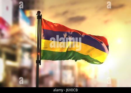 Mauritius Flag Against City Blurred Background At Sunrise Backlight - Stock Photo