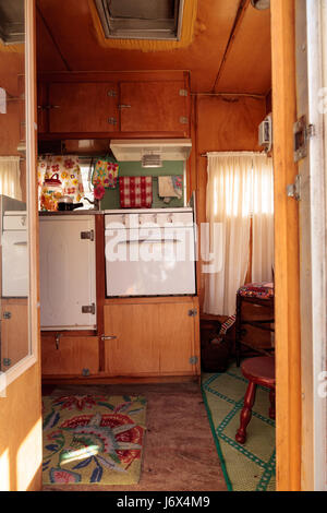 Small retro caravan camper used as a tiny house on road trips Stock