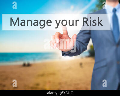 Manage your Risk - Businessman hand pressing button on touch screen interface. Business, technology, internet concept. - Stock Photo