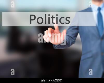 Politics - Businessman press on digital screen. Business,  internet concept. Stock Photo - Stock Photo