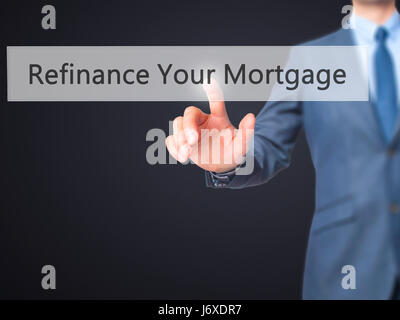 Refinance Your Mortgage - Businessman hand pressing button on touch screen interface. Business, technology, internet - Stock Photo