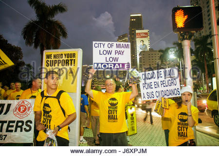 Miami Florida Biscayne Boulevard protesters protesting police policemen firefighters firemen city employees budget - Stock Photo
