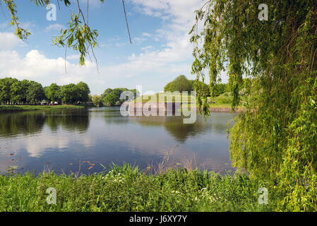 NAARDEN - NETHERLANDS - MAY 13, 2017: Naarden is an example of a star fort, complete with fortified walls and a - Stock Photo
