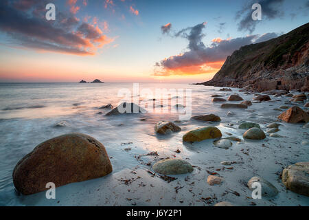 Beautiful sunset over Porth Nanven beach in the far west of Cornwall - Stock Photo