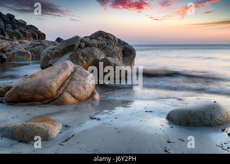 Sea sculpted rocks on the beach at Porth Nanven near Land's End on the Cornwall coastline - Stock Photo