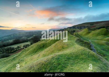 Dawn over the Llangattock Escarpment in the Brecon Beacons National Park in Wales - Stock Photo