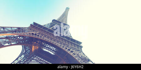 Angle shot of The Eiffel Tower in Paris, France. Retro style image. Copyspace composition - Stock Photo