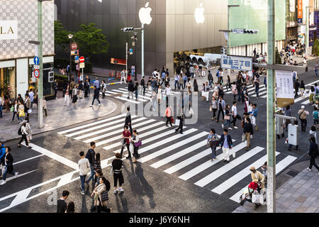 TOKYO - MAY 7, 2017: People wandering around the streets of Ginza, the luxurious shopping district in Tokyo, Japan - Stock Photo