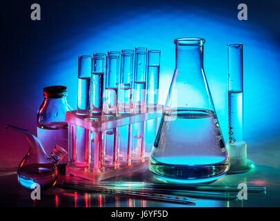 Different laboratory beakers and glassware. Multicolored. - Stock Photo