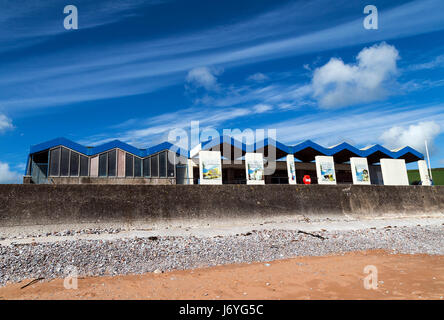 Broadsands beach,Beachhuts and green fieldssandBroadsands beachBeachhuts and green SEASIDESCENESEASHOREBATHERSCOASTALVIEWtradition - Stock Photo