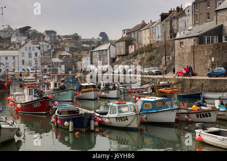 UK, Cornwall, Mevagissey, working boats moored in the harbour at East Quay - Stock Photo