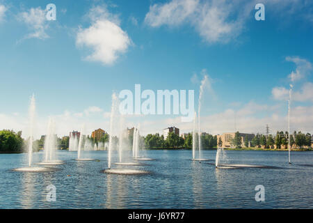 Water fountains in lake, Oulu, Finland - Stock Photo