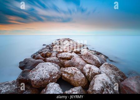 Stone jetty on beach, Venice, Italy - Stock Photo