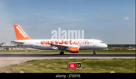 EasyJet G-EZUP Airbus A320-214 on the runway at Schiphol Airport, Amsterdam, Netherlands, Europe - Stock Photo
