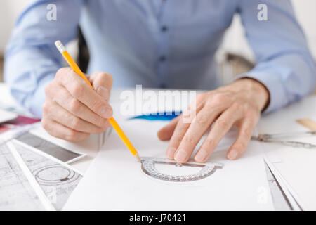 Professional engineer using a protractor - Stock Photo