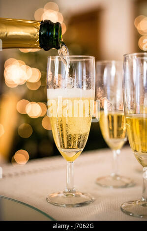 pouring out champagne - Stock Photo