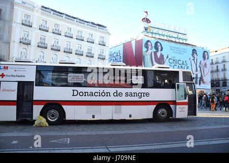 Blood donation bus, Plaza de la Puerta del Sol, Madrid, Spain - Stock Photo