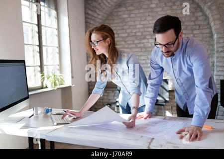 Coworking process, designers team working in modern office - Stock Photo