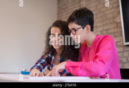 Group of young colleagues working together in office - Stock Photo