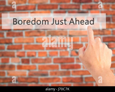 Boredom Just Ahead - Hand pressing a button on blurred background concept . Business, technology, internet concept. - Stock Photo