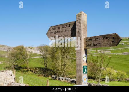 Pennine Way sign signpost on footpath to Malham Cove. Malham, Malhamdale, Yorkshire Dales National Park, North Yorkshire, - Stock Photo