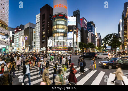 TOKYO - MAY 4, 2017: Pedestrian cross the street in famous luxury shopping district of Ginza in the heart of Tokyo, - Stock Photo