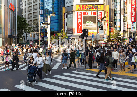 TOKYO - MAY 5, 2017: People walk across the streets in the very busy Shinjuku district in Tokyo, Japan capital city. - Stock Photo