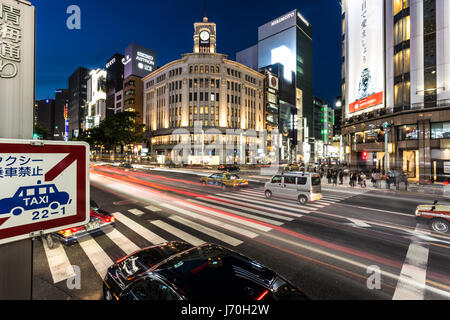 TOKYO - MAY 8, 2017: A bus rushes through an intersection in Ginza, the famous luxury shopping district in Tokyo - Stock Photo