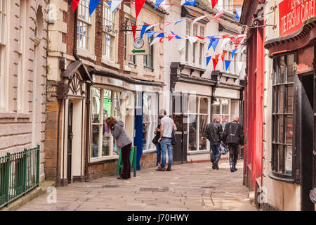 Shoppers and visitors in Grape Lane, Whitby, North Yorkshire, England. - Stock Photo