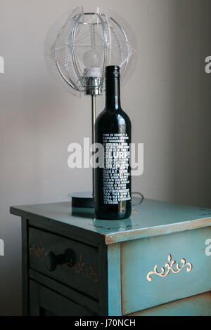 Bottle of red wine on wooden table - Stock Photo