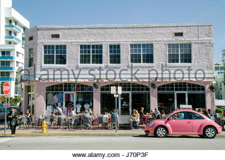 Miami Beach Florida Collins Avenue Big Pink restaurant alfresco al fresco dining Volkswagen delivery vehicle - Stock Photo