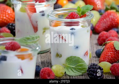 Three glasses with plain yogurt and mixed fresh fruit - Stock Photo