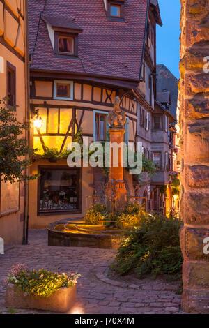 Evening at the medieval entry gate (La Porte Haute), Riquewihr, Alsace, Haut-Rhin, France - Stock Photo