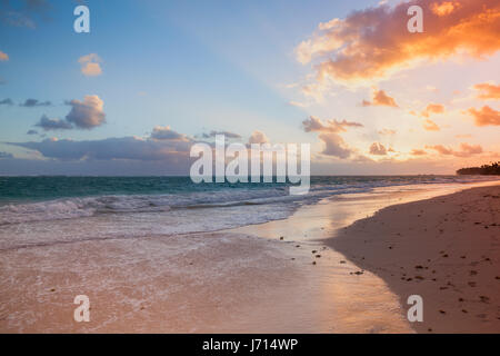 Orange sunrise over Atlantic Ocean coast, Bavaro beach, Hispaniola Island. Dominican Republic, coastal landscape - Stock Photo