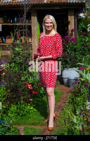 Chelsea London UK 22nd May 2017 RHS Chelsea Flower Show Radio 2 Presenter Anneka Rice poses in amongst the flowers - Stock Photo