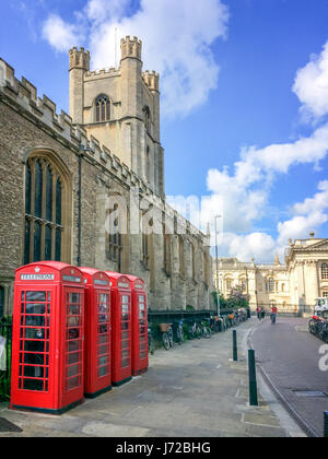 Old style British telephone booths by Great Saint Mary church in the University city of Cambridge, UK - Stock Photo