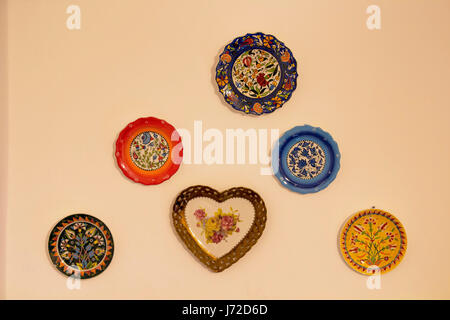 Decorative ceramic plates on beige wall. Traditional Turkish - Ottoman floral motives and patterns are applied. - Stock Photo