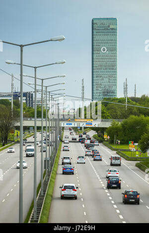 MUNICH, GERMANY - MAY 6, 2017 : The traffic on Georg Brauchle Ring highway with the Munich Uptown Building in the - Stock Photo