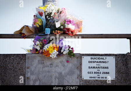 Floral tributes laid in memory of a suicide victim on Itchen bridge in Southampton, UK, with the Samaritans helpline - Stock Photo