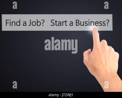 Find a Job? Start a Business? - Hand pressing a button on blurred background concept . Business, technology, internet - Stock Photo