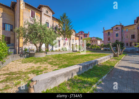 Rome, Italy - The suggestive popular Garbatella quarter in Ostiense district, an agglomeration in Rococo style with - Stock Photo