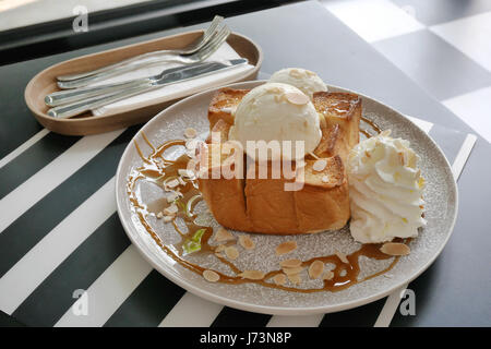 Almond honey toast with vanilla ice cream. - Stock Photo