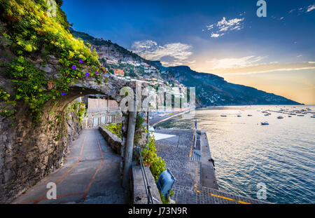 Positano is a village and comune on the Amalfi Coast (Costiera Amalfitana), in Campania, Italy, mainly in an enclave in the hills leading down to the  Stock Photo