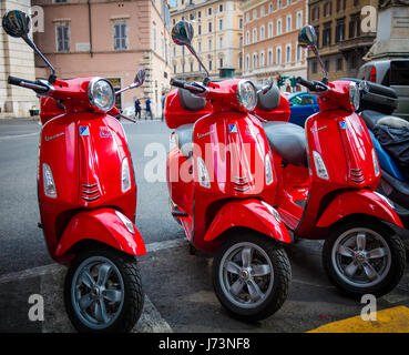 Three red Vespas on Piazza di San Pantaleo in Rome, Italy - Stock Photo