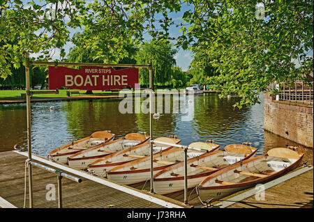 White rowing boats moored on the River Avon in Stratford upon Avon, Warwickshire. - Stock Photo