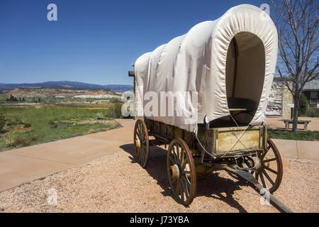Replica of Old West Wagon Wheel at Hole in the Rock Heritage Center near town of Escalante in Utah - Stock Photo