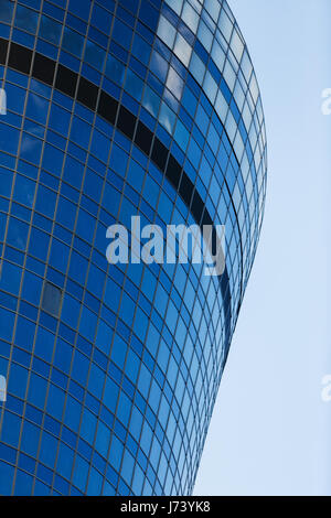 Round tall building against sky - Stock Photo